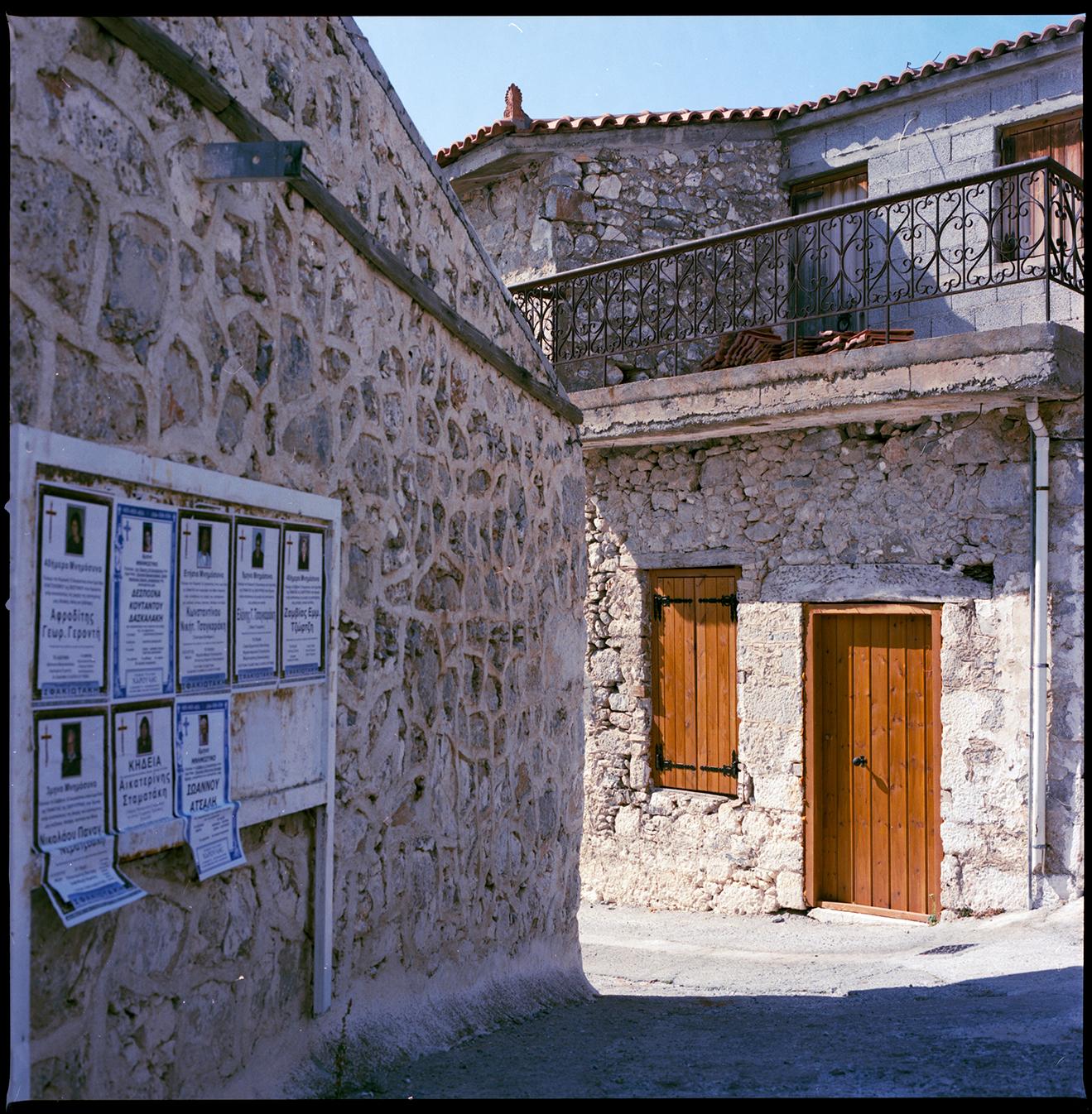 Small alleyway between stone houses in Crete