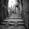 Black and white square photo of an alleyway in the old city of Jerusalem