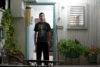 Young man standing in home's doorway